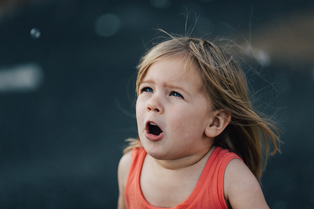 toddler opening her mouth