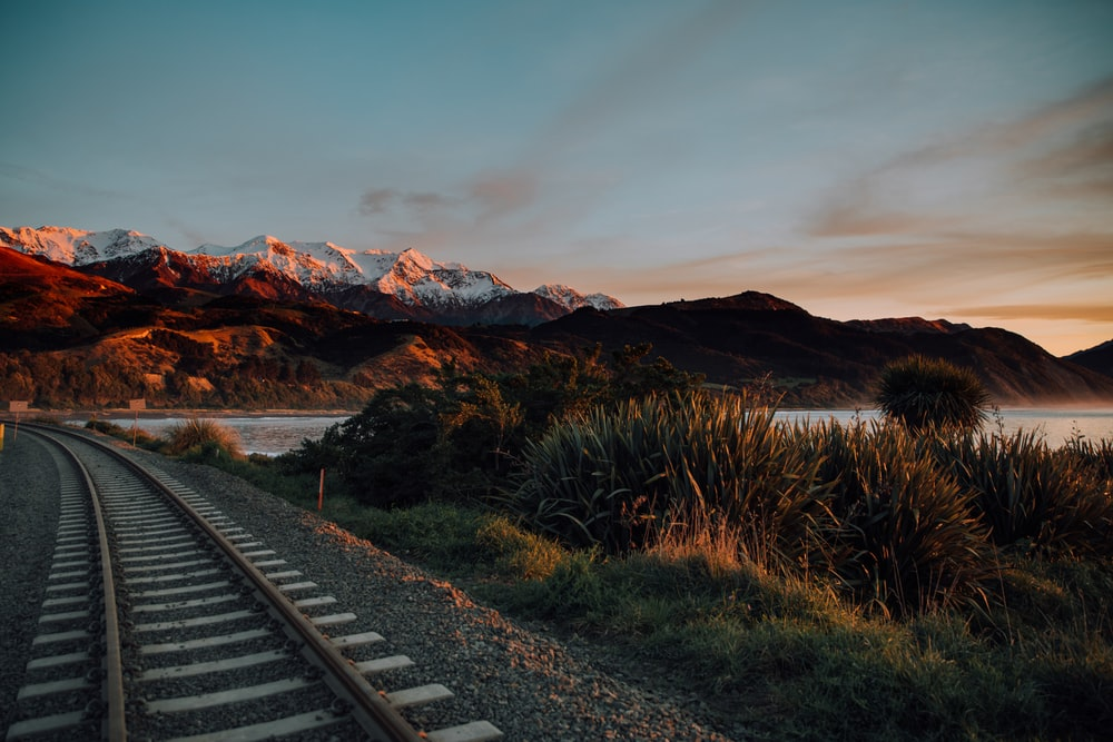 train rail under blue sky