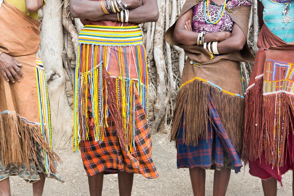 four people wearing fringed clothes