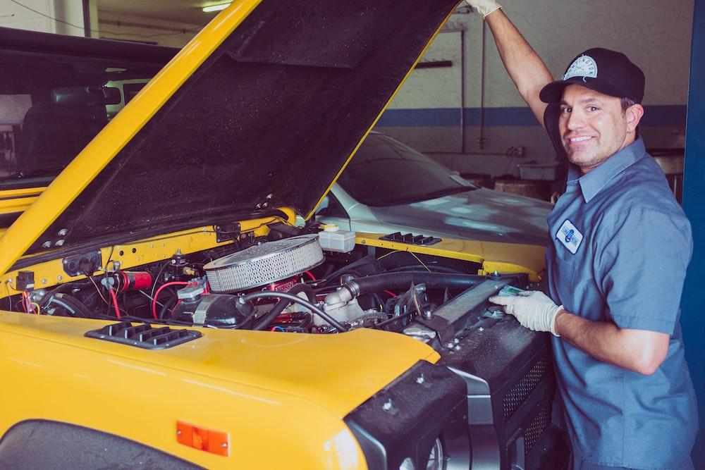 man holding open-wide car trunk