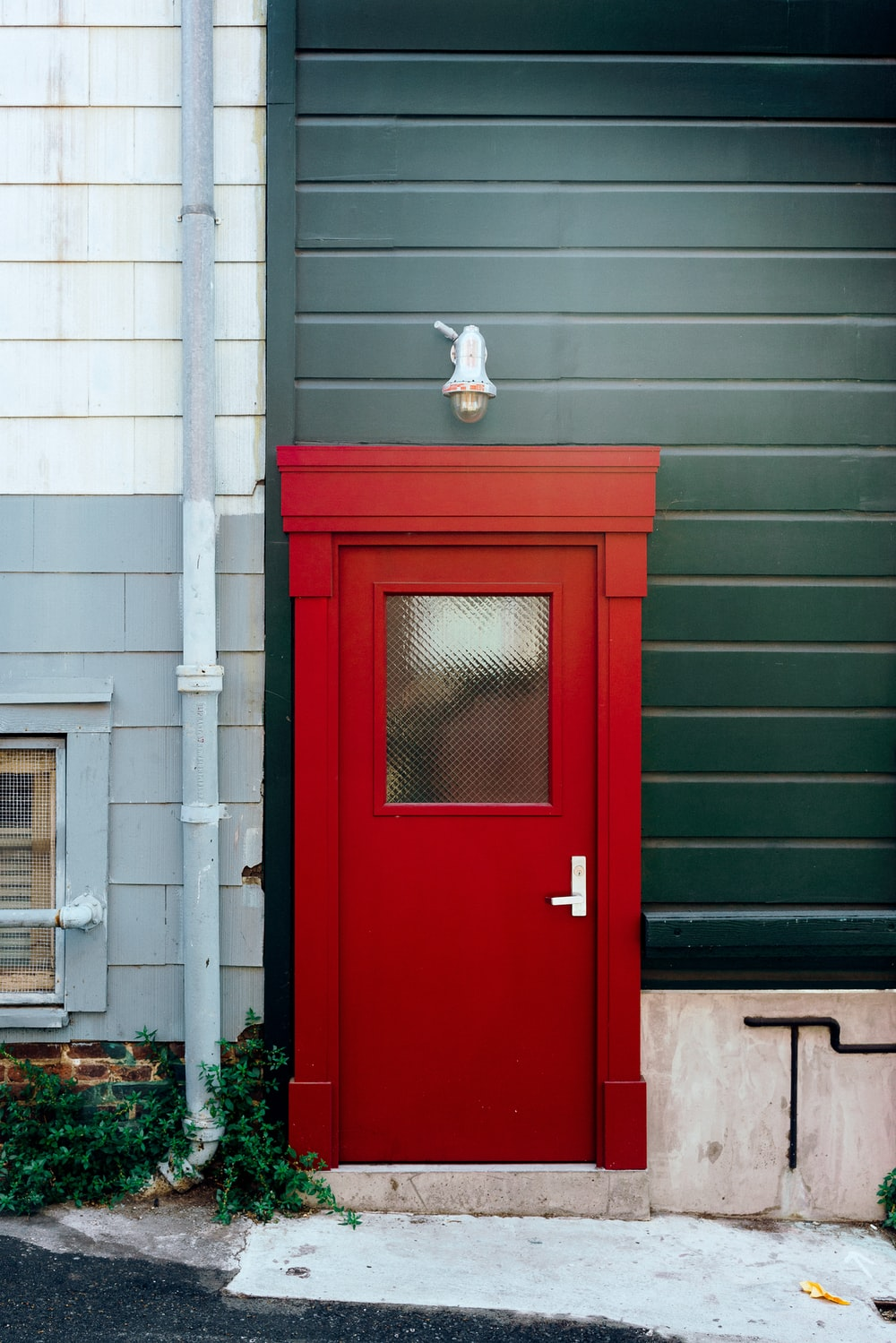 red painted door with green wall
