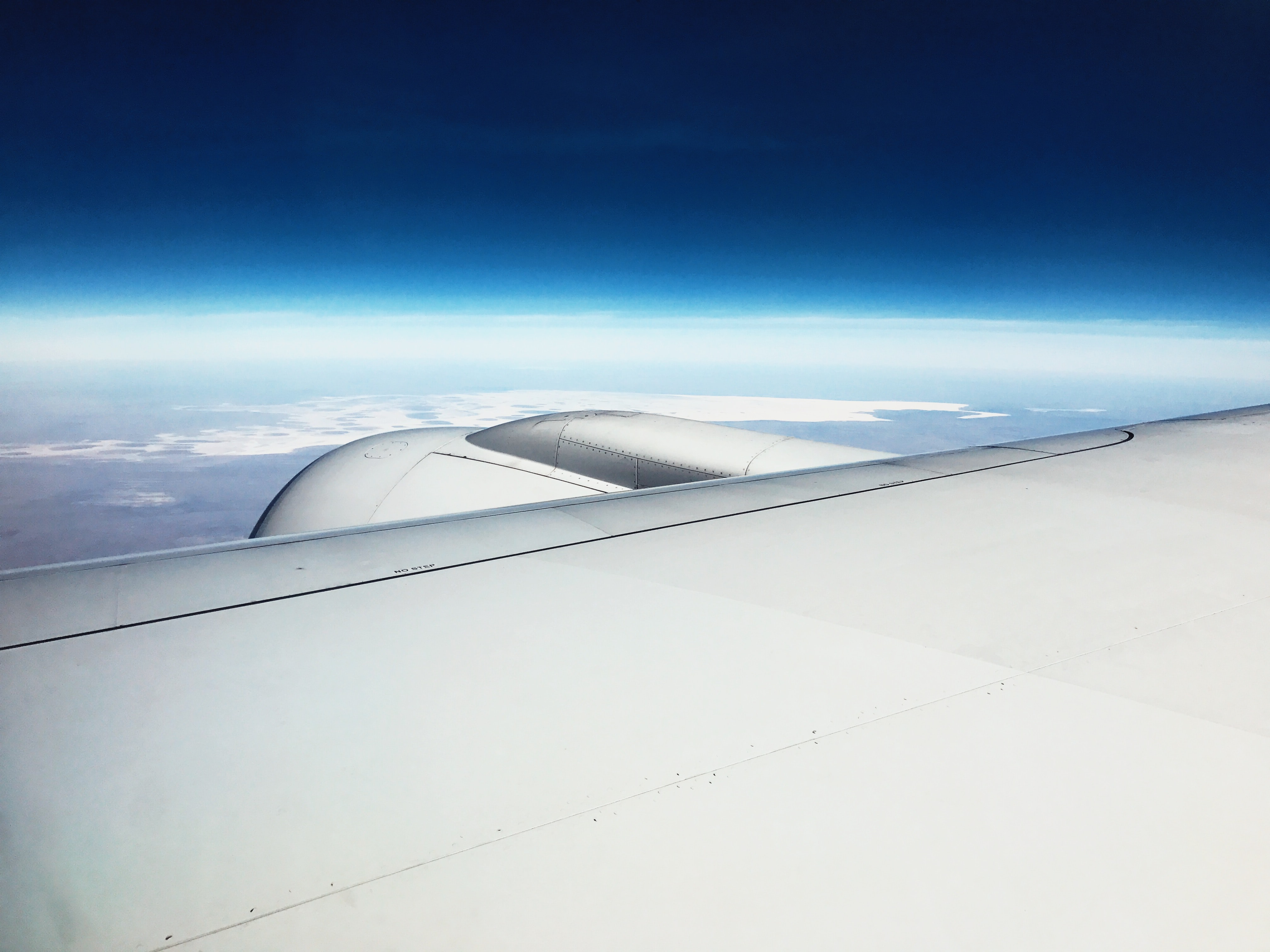 airplane wing under blue sky