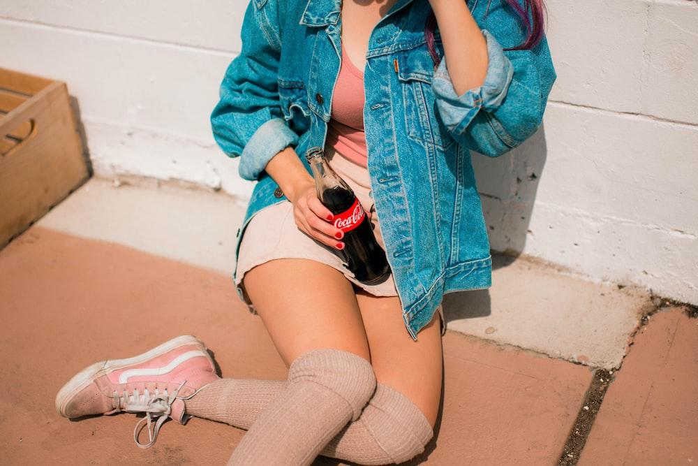 woman holding Coca-Cola bottle