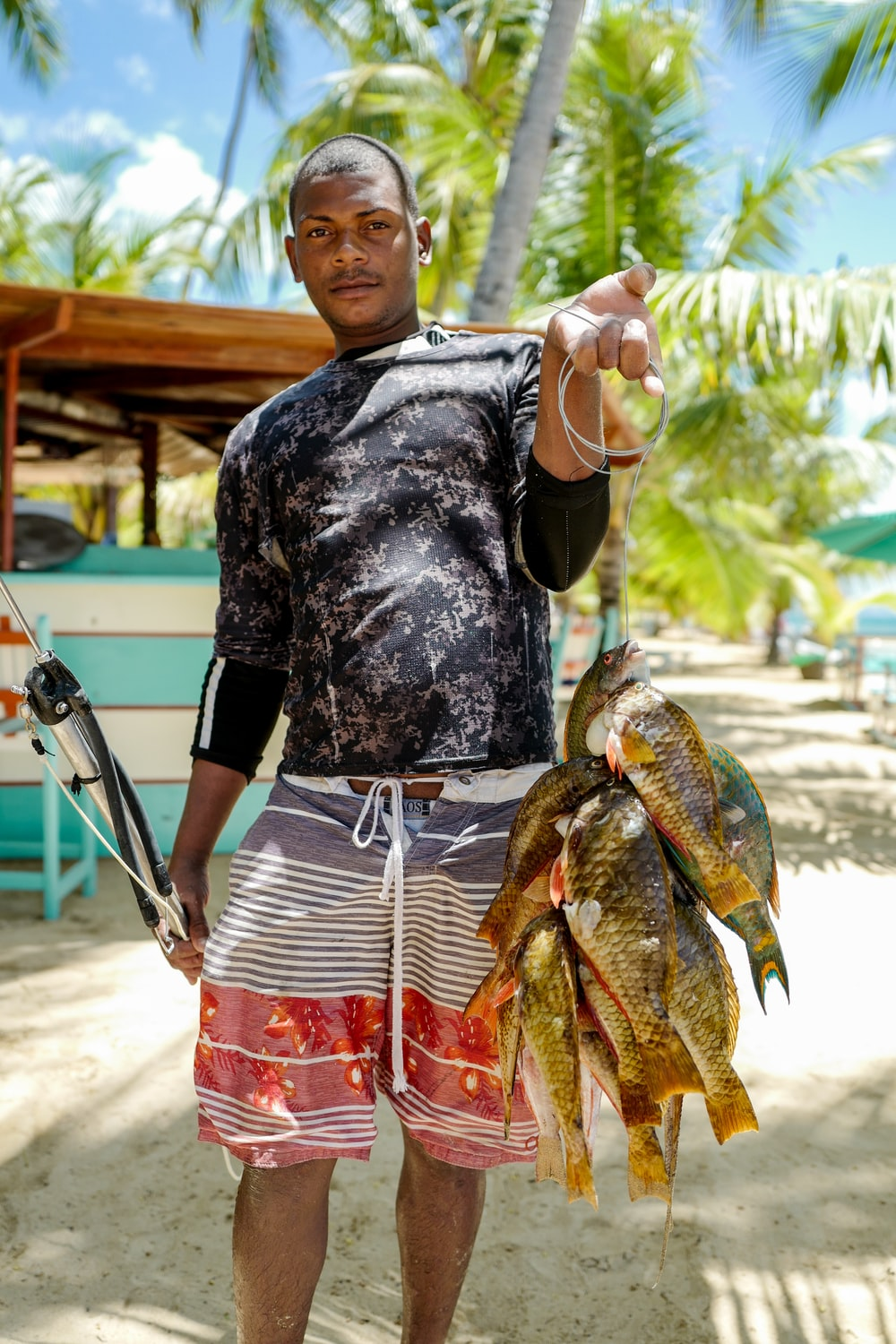 man carrying brown fishes