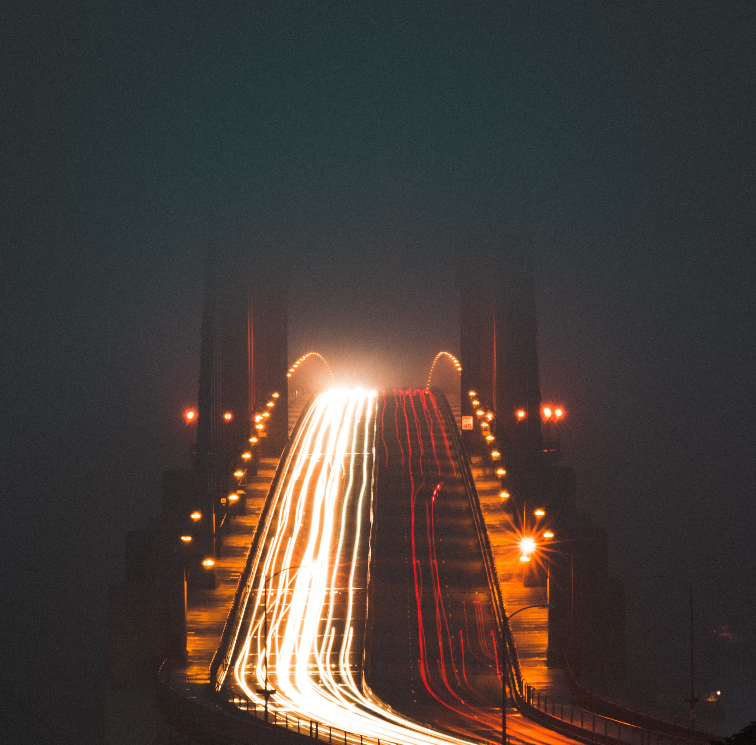 timelapse photography of bridge during night time
