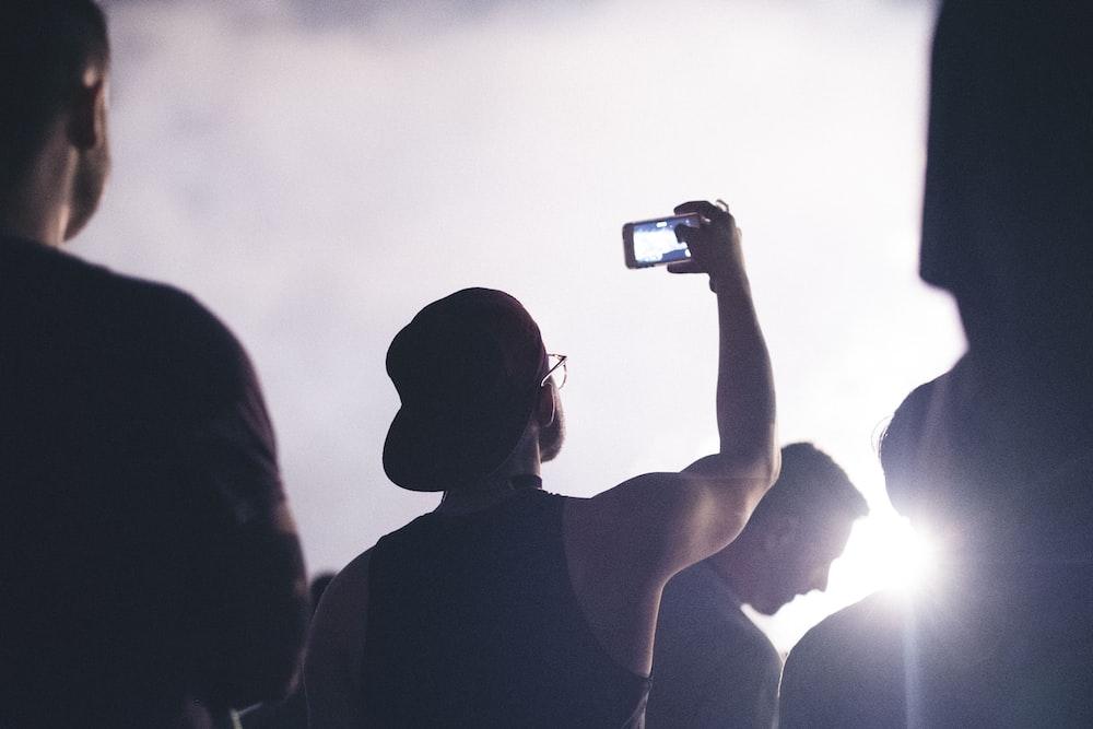 man using taking phtoo smartphone