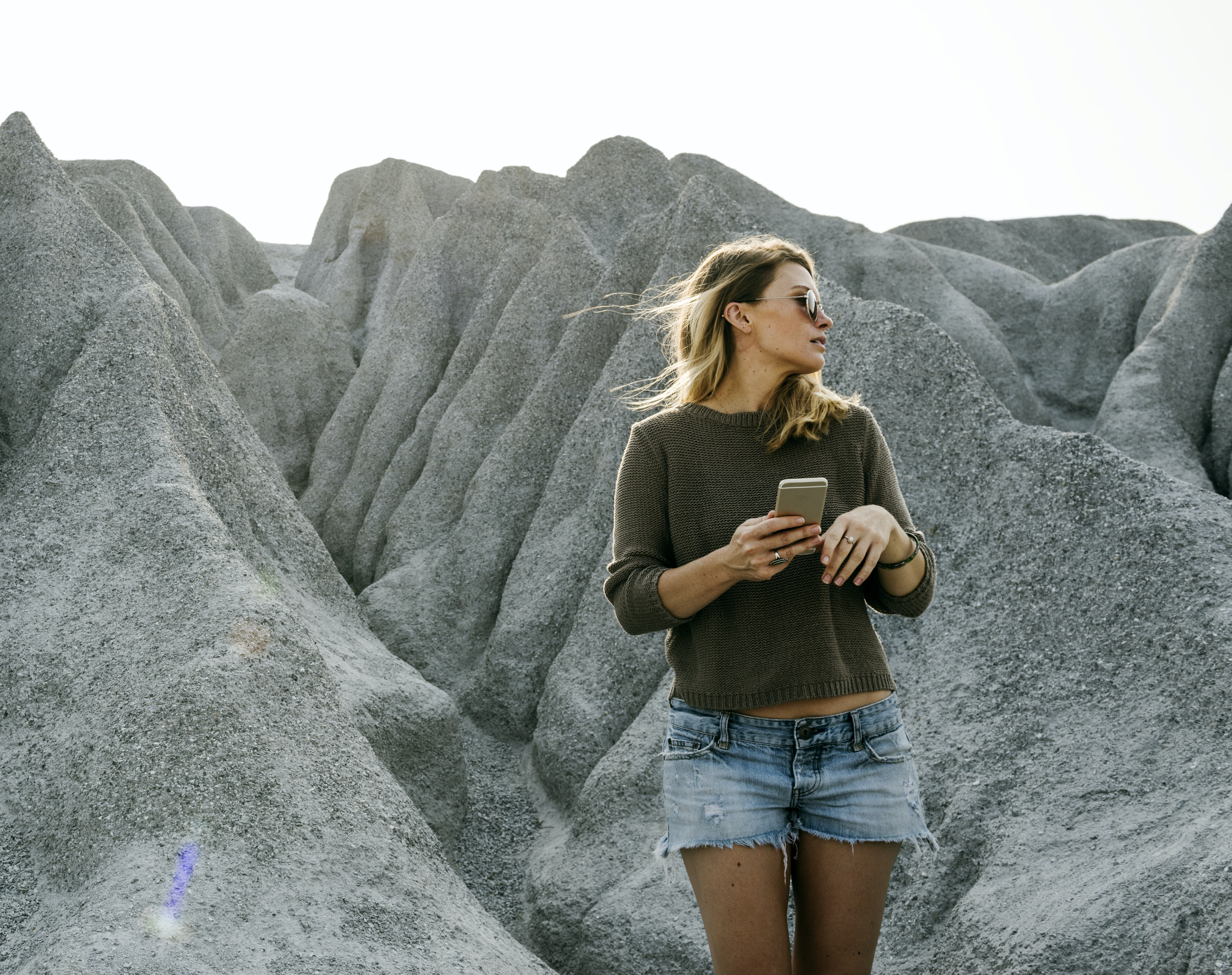 woman standing behind sand mountain