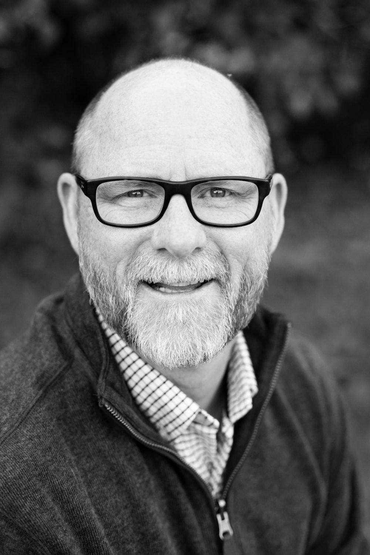 grayscale of man wearing eyeglasses