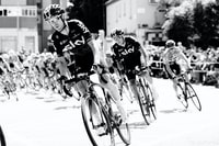 grayscale photo of cyclist