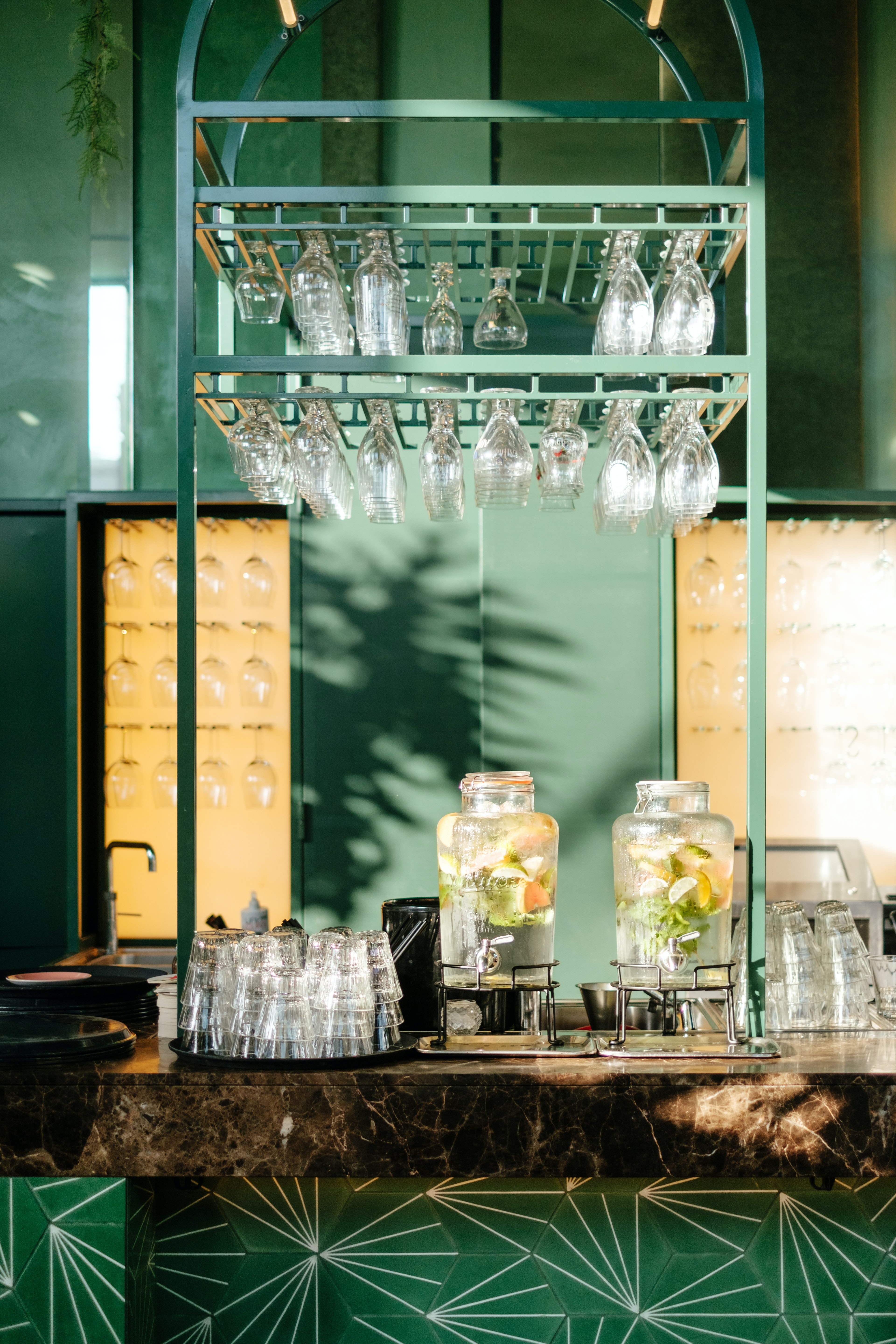assorted bar ware glasses in silver glass rack
