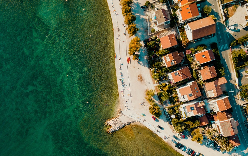 bird's eye view photography of buildings near body of water