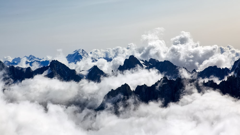 aerial photography of sea of clouds and mountain