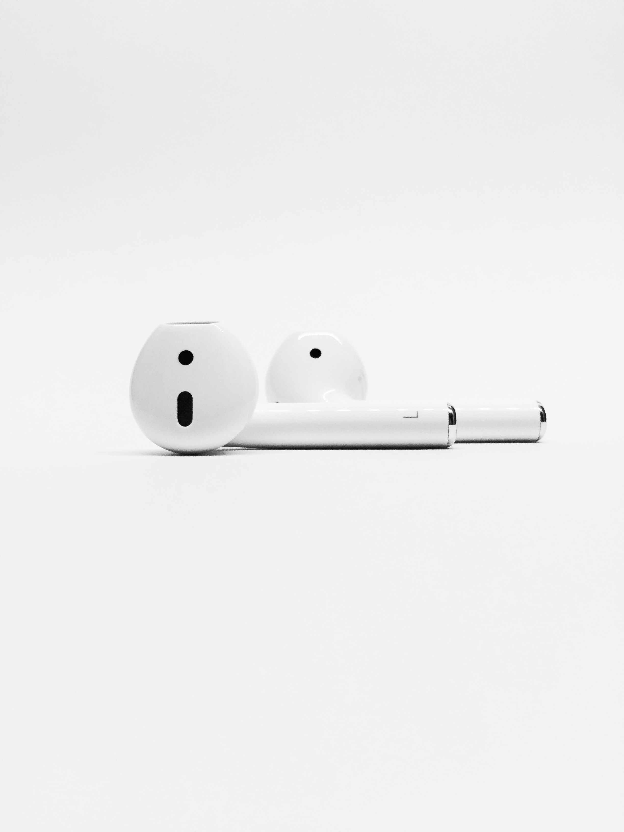 A close-up view of white wireless earphones.