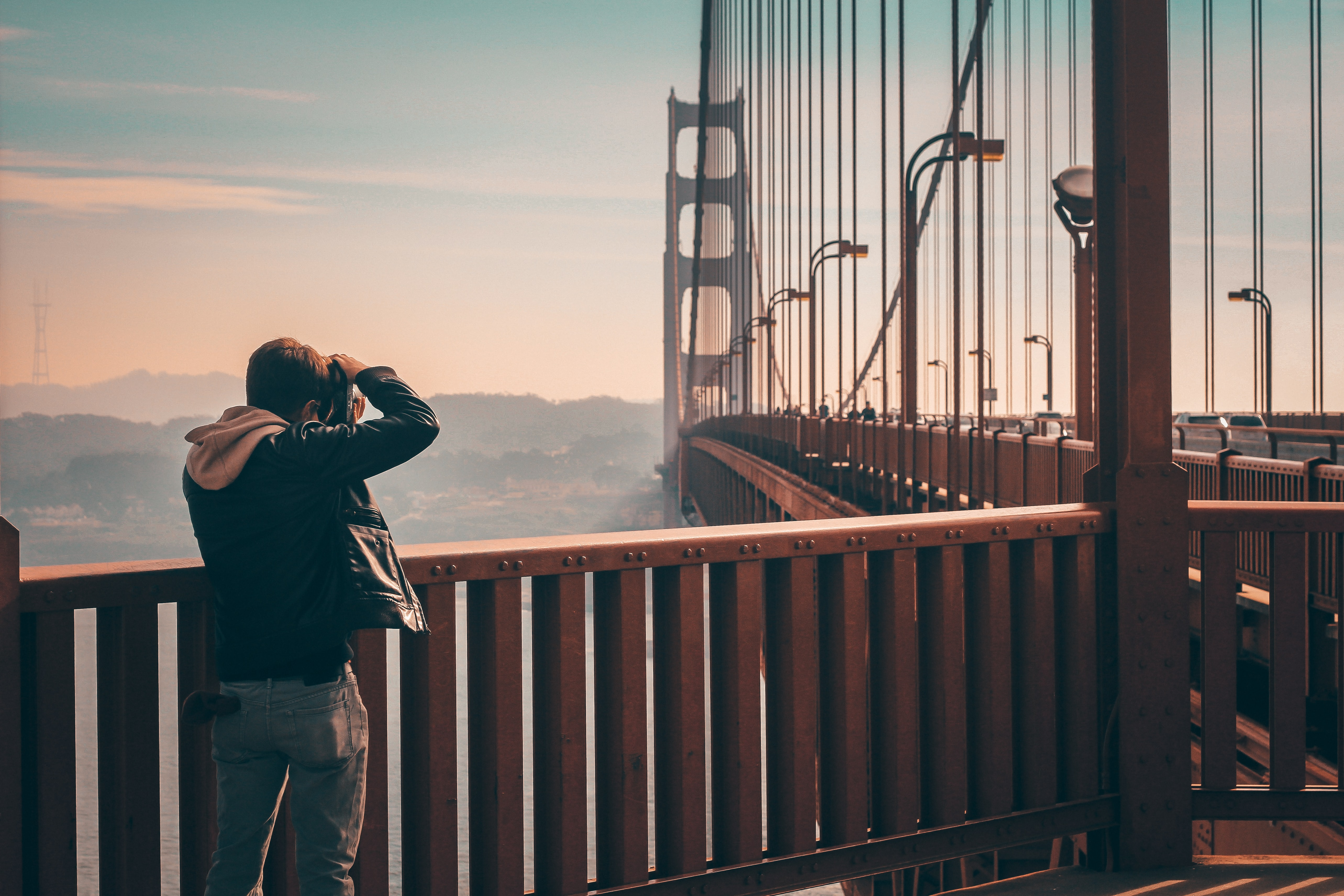 person standing on bridge taking picture