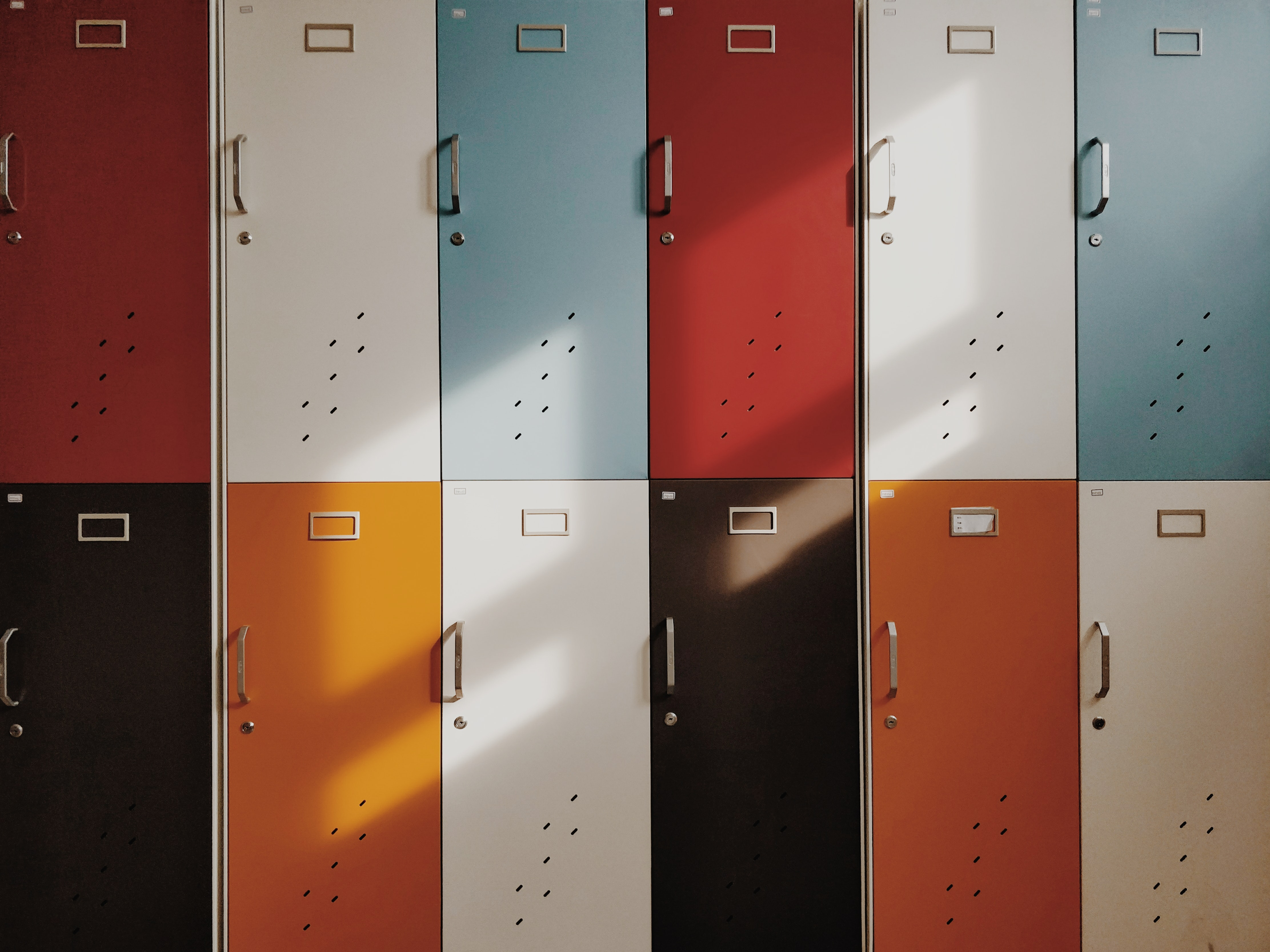 Six doors of varying colors stacked on top of each other.
