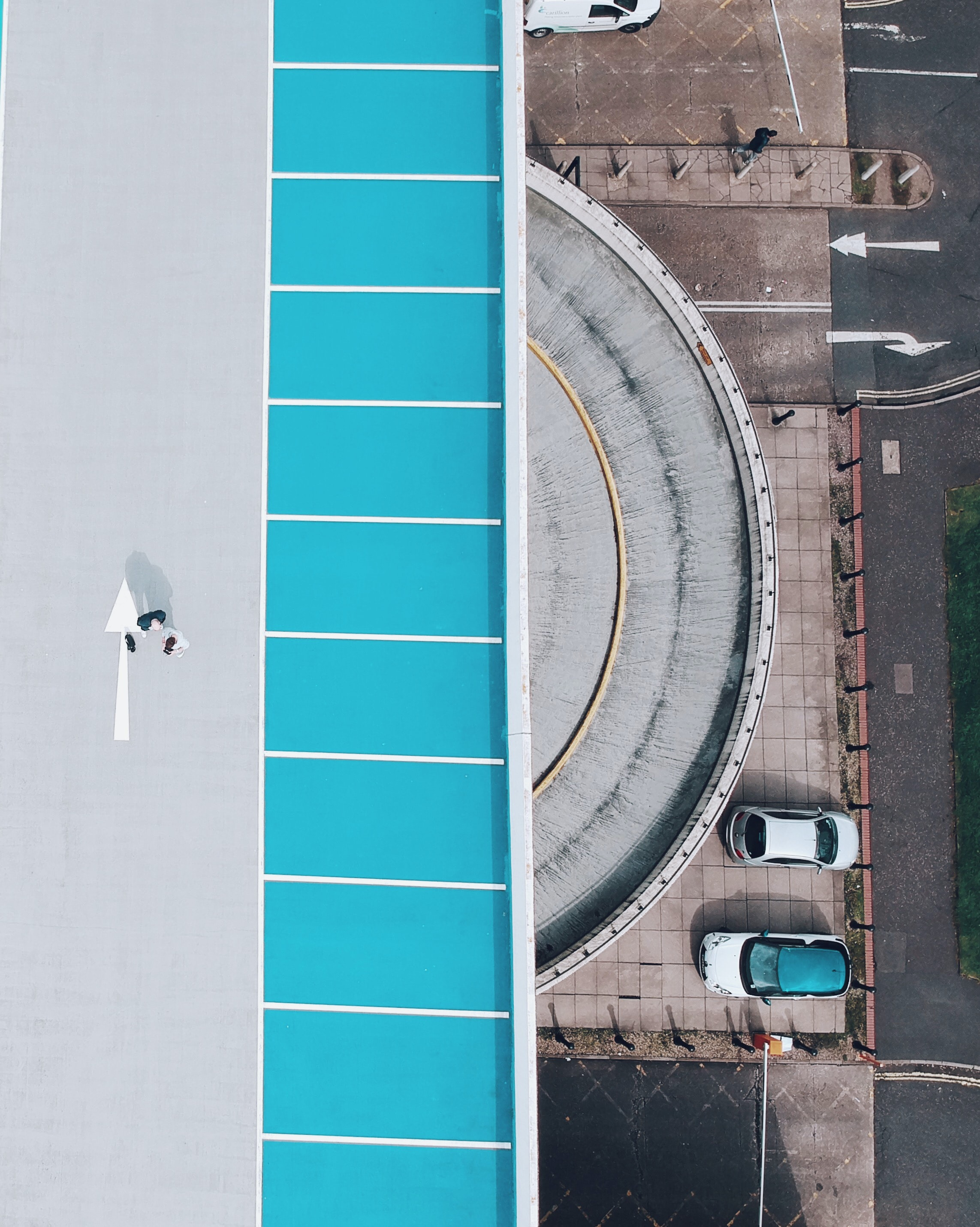 bird's eye photography of two cars parked near dome