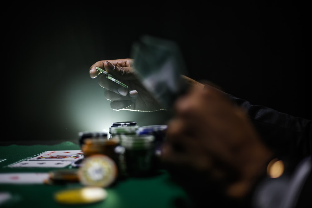 selective focus photography of poker chips