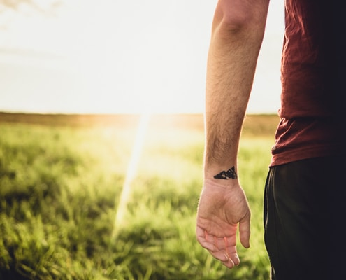person tattoo on wrist