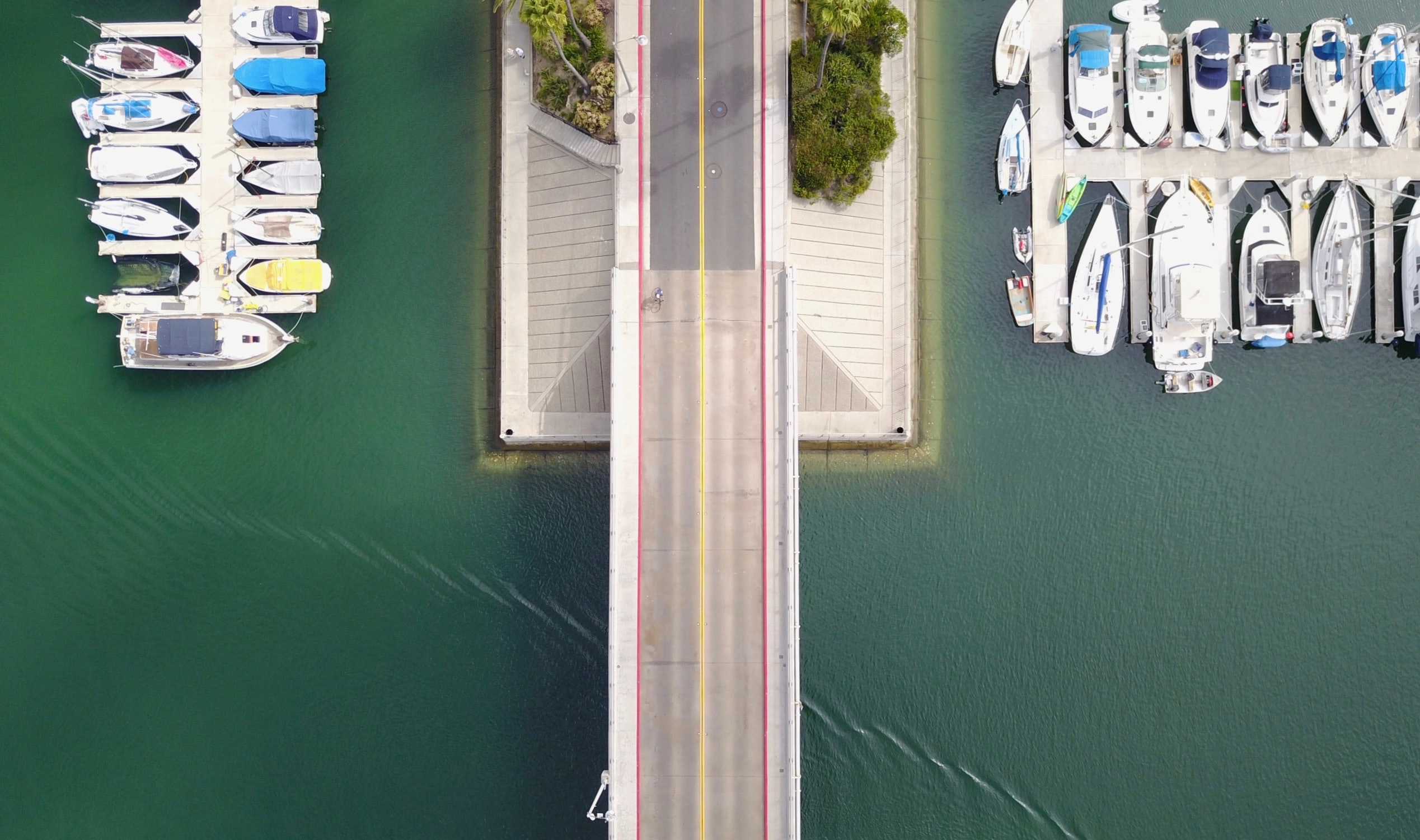 A road leading to the dock at a boatyard.