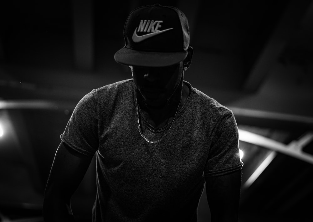 silhouette photo of man in Nike cap