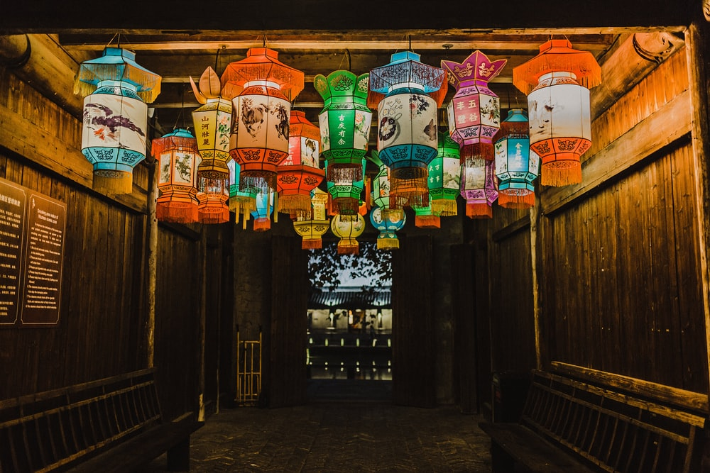 photo of assorted-color Chinese lanterns inside room