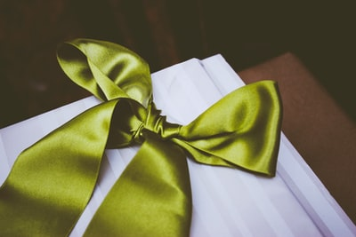 green bow tie on table decoration teams background