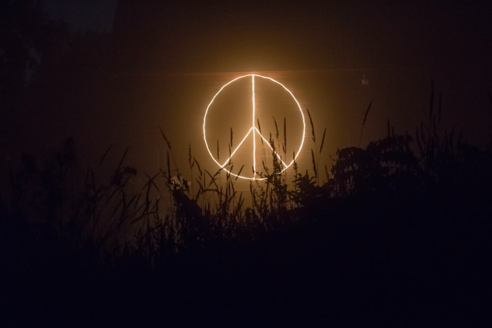 Peace sign logo neon signage