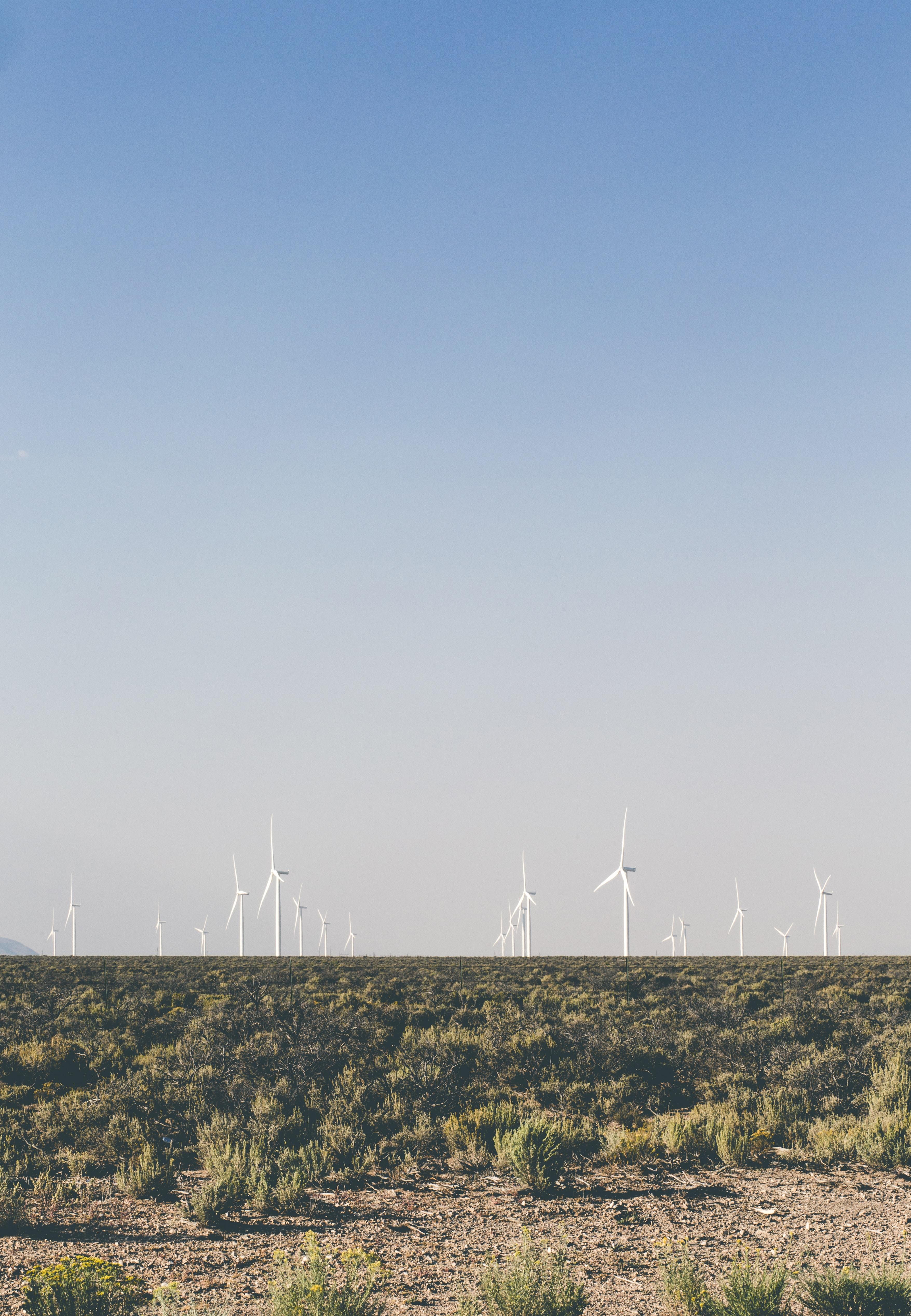 photo of white wind turbines