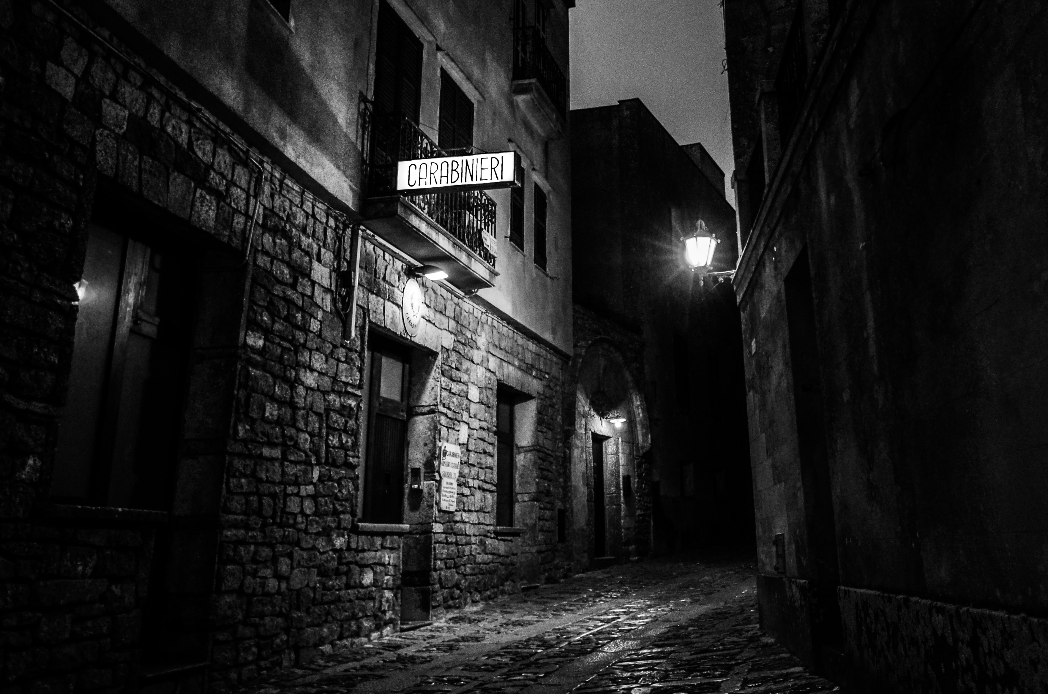 city alleyway with Carabineri signage during nighttime