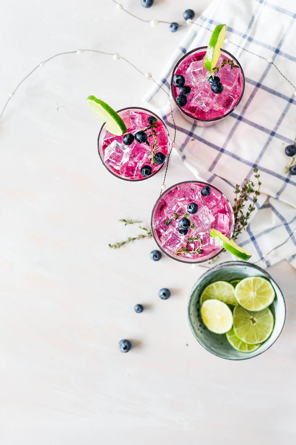 pink liquids served in drinking glasses