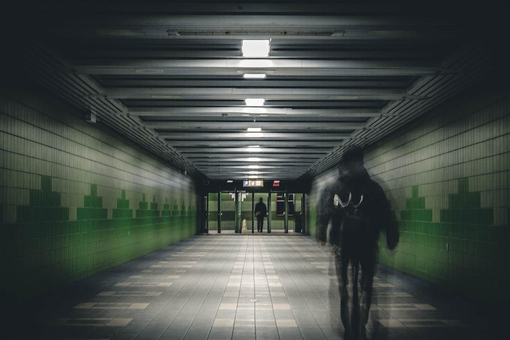 man walking on train subway