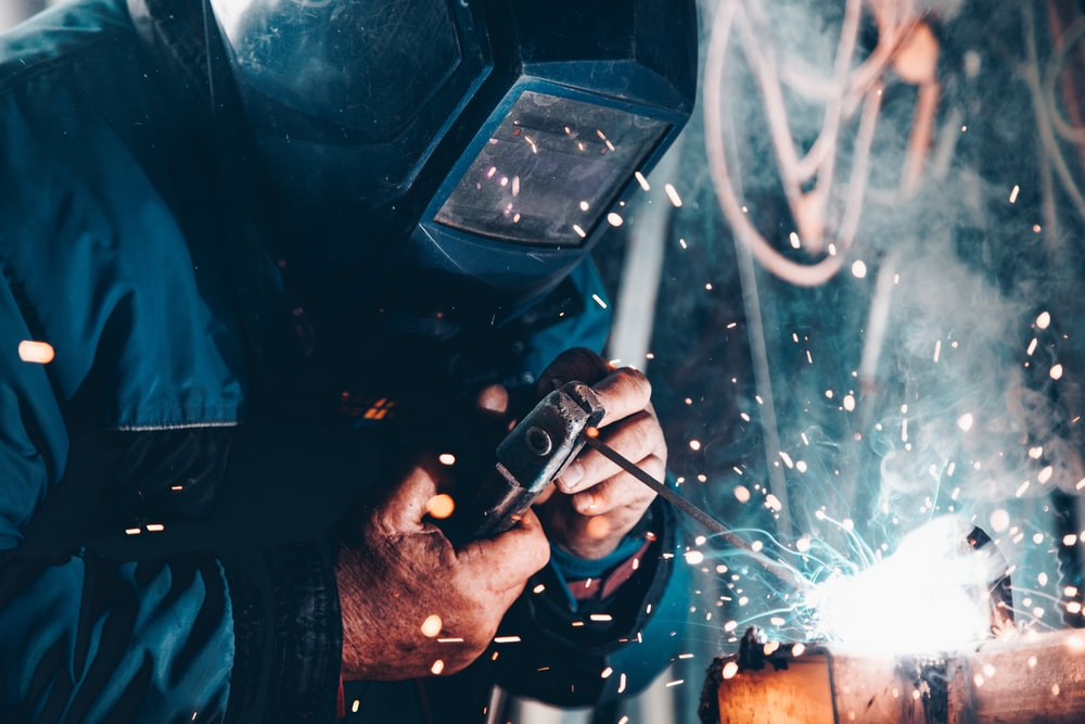 man using welding machine