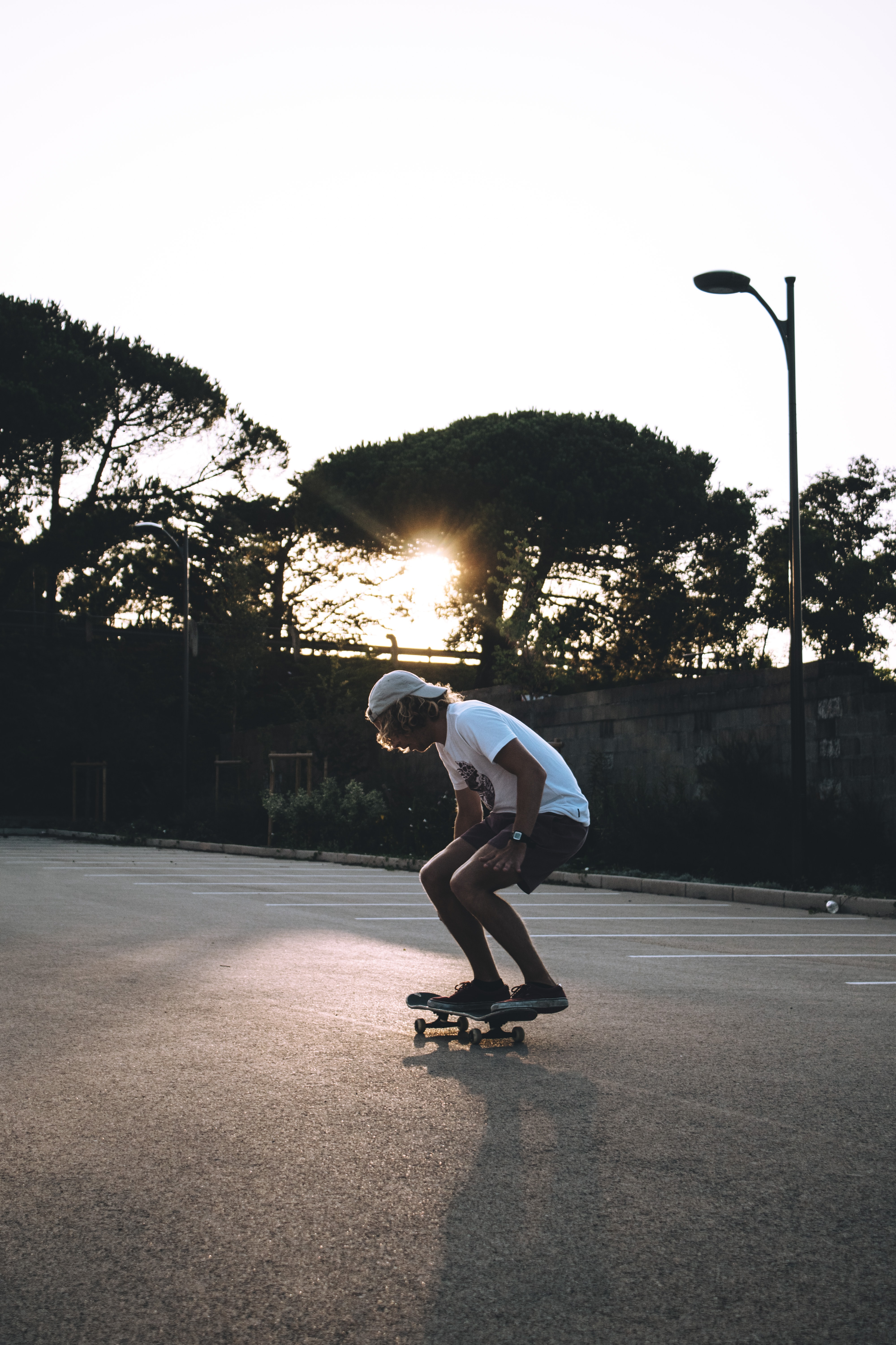 man riding skateboard at the middle of the empty road