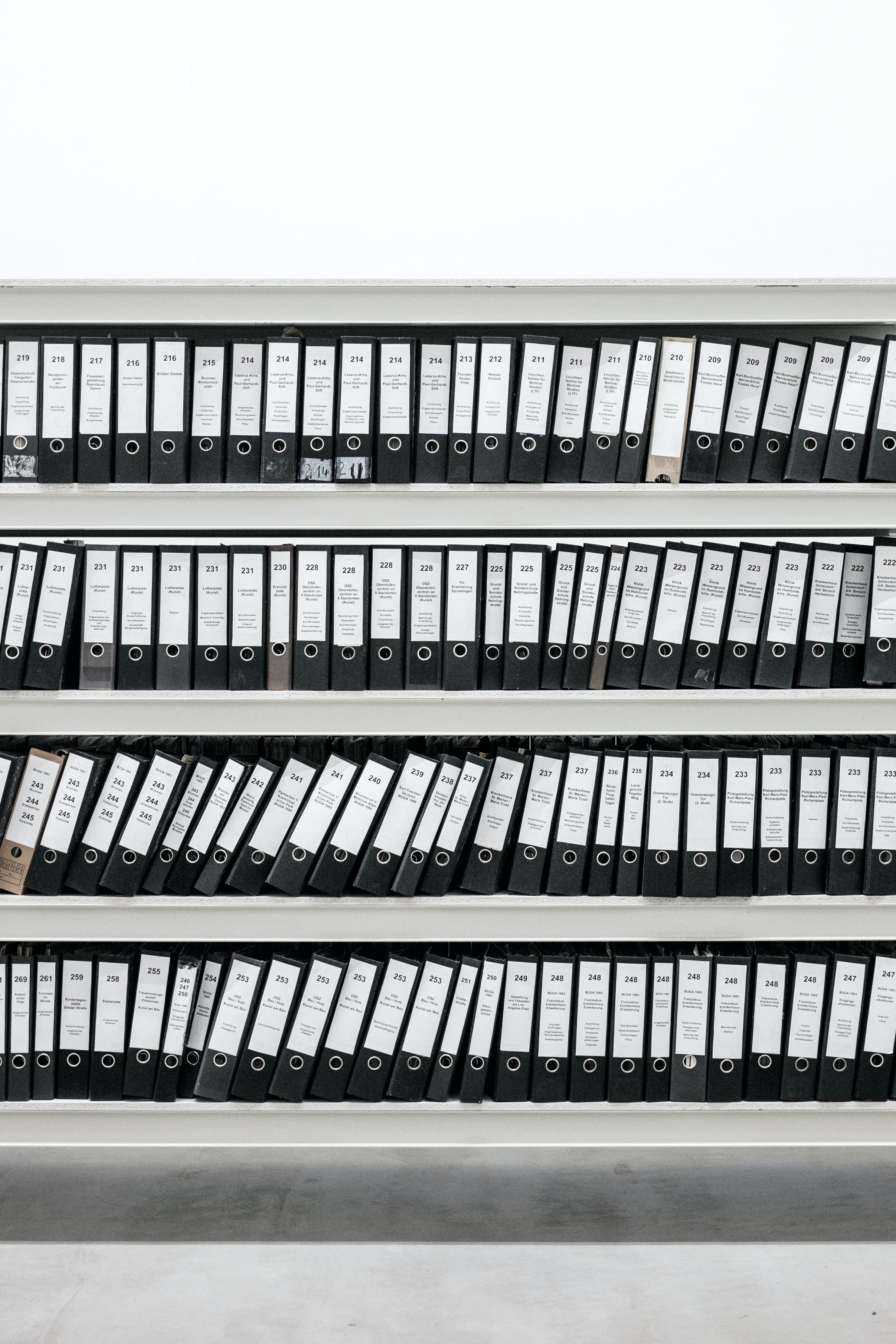black binders on steel rack