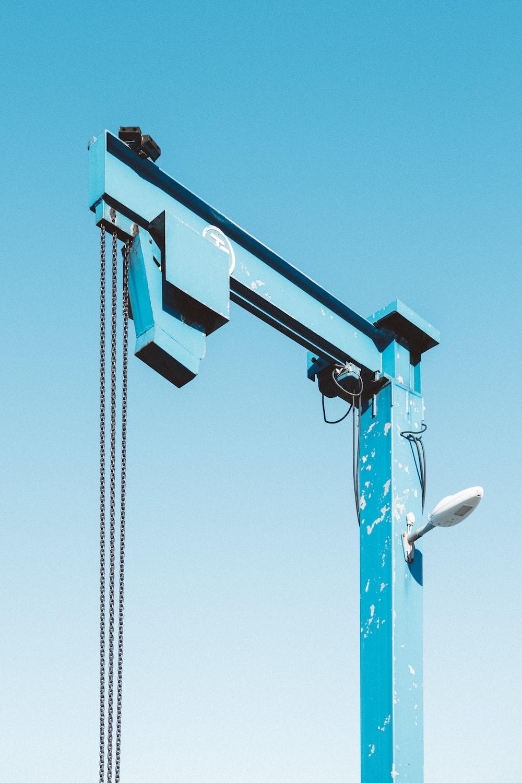 blue lift machine under blue skies