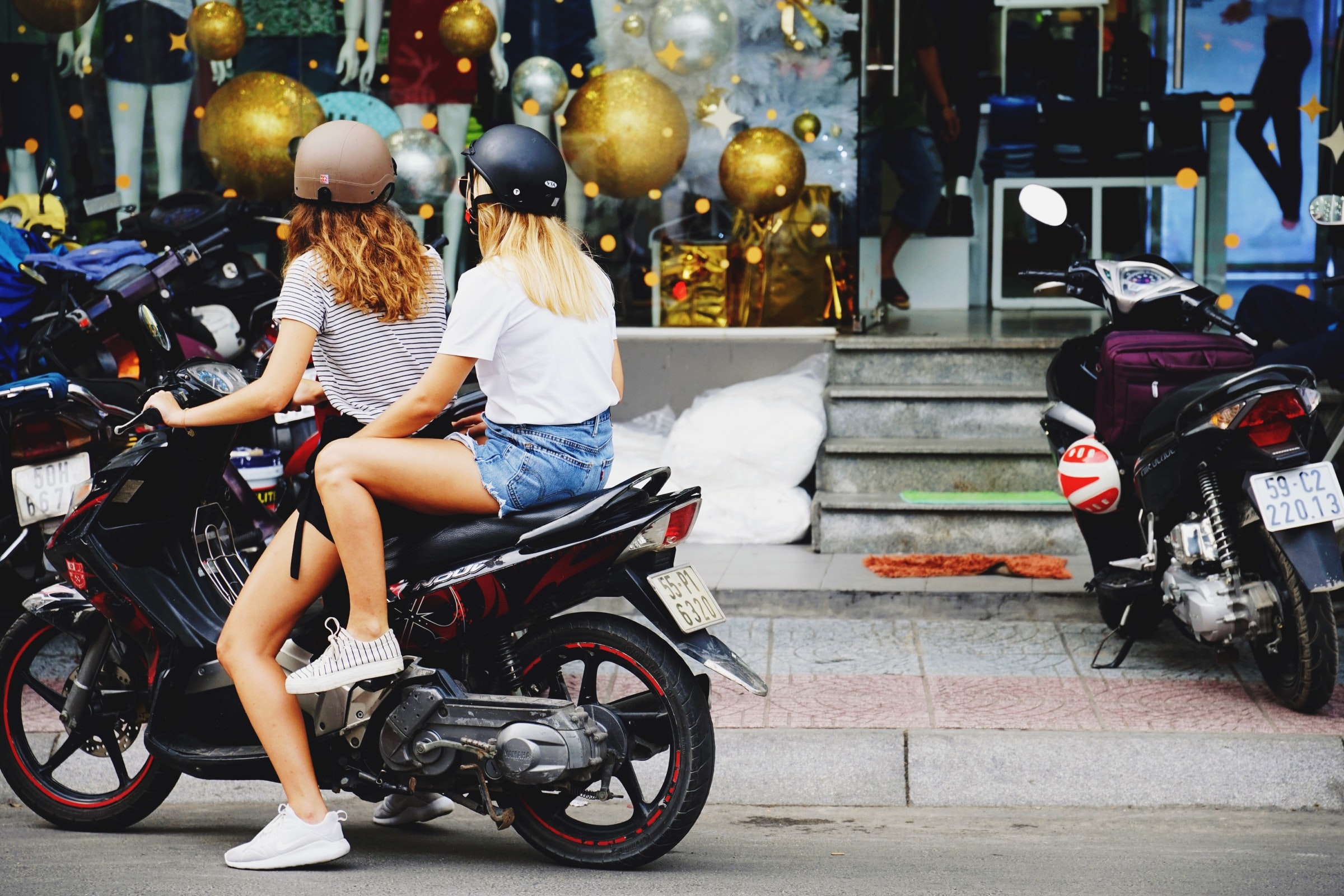 two women riding motorcycle