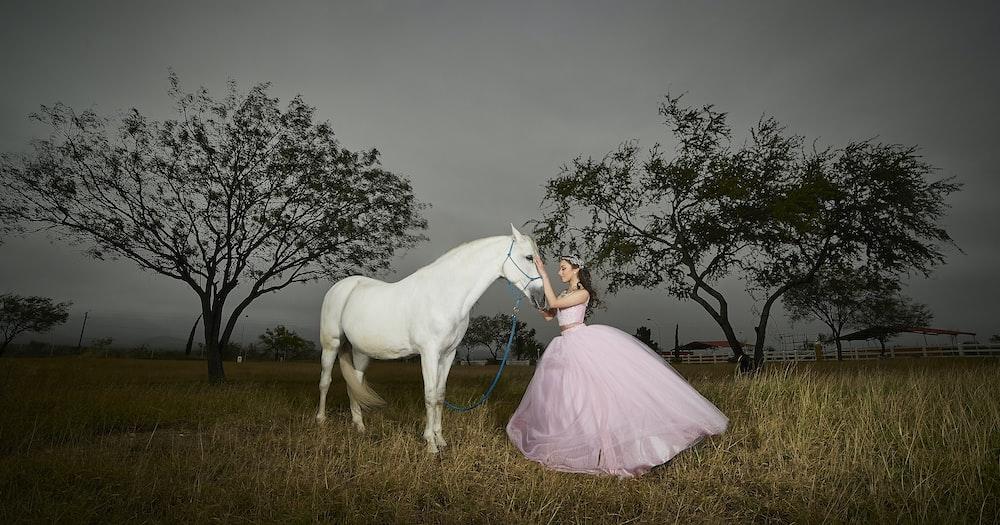 girl holding white horse head