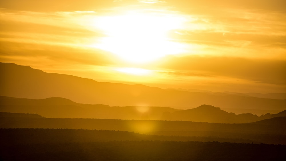 silhouette of mountains during golden hour