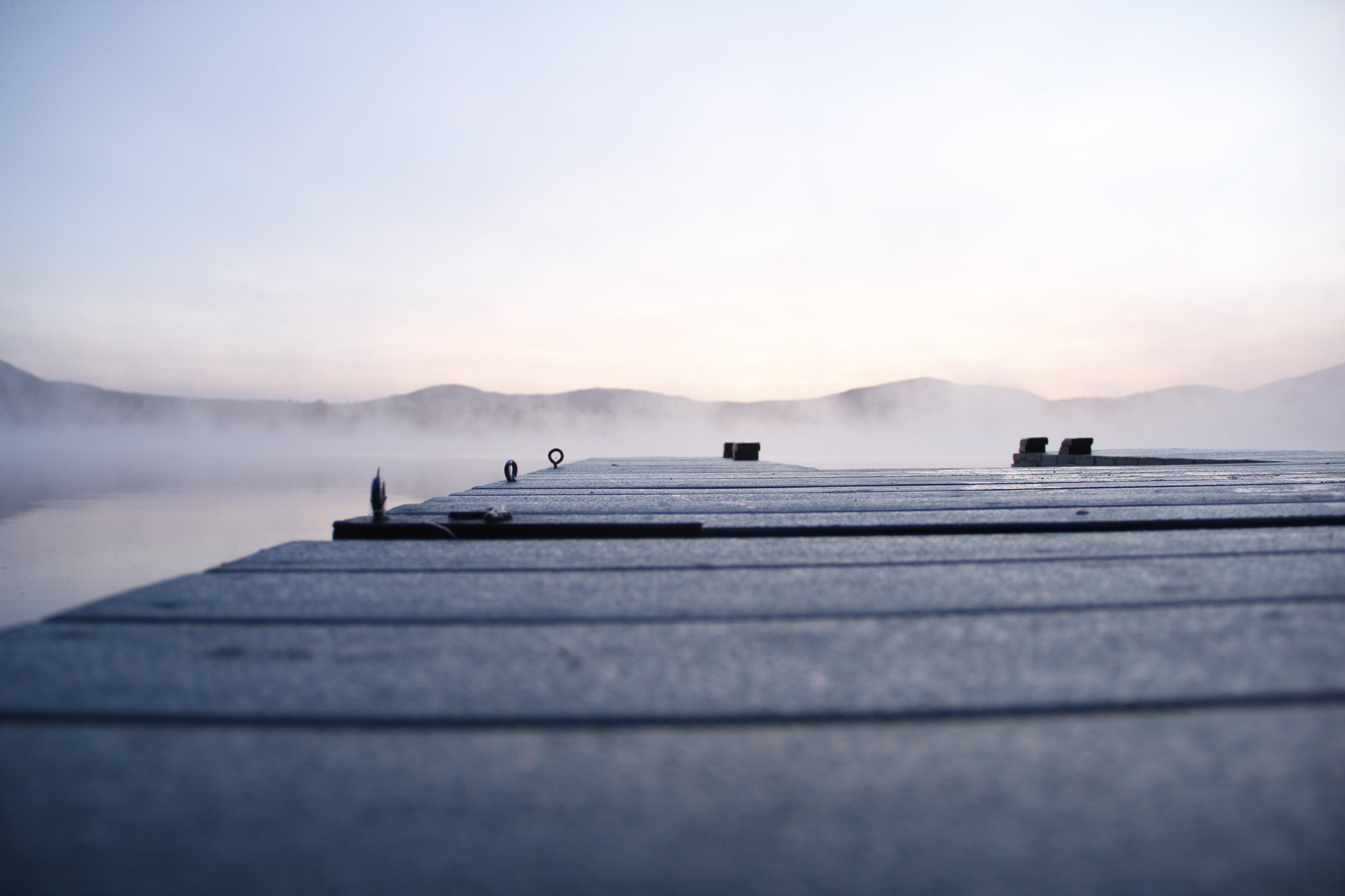 shallow focus photography of grey bridge