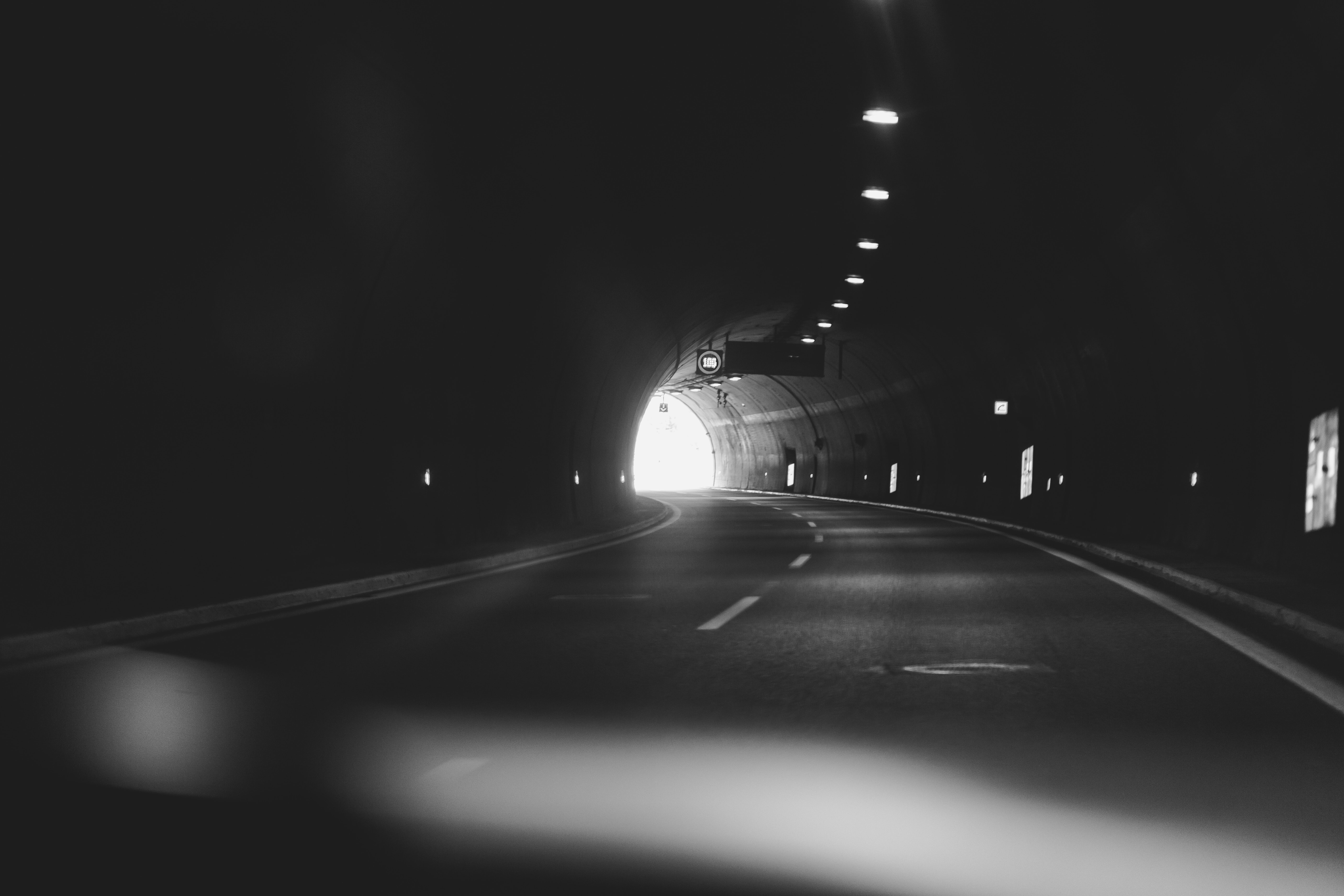 grayscale photography of a tunnel
