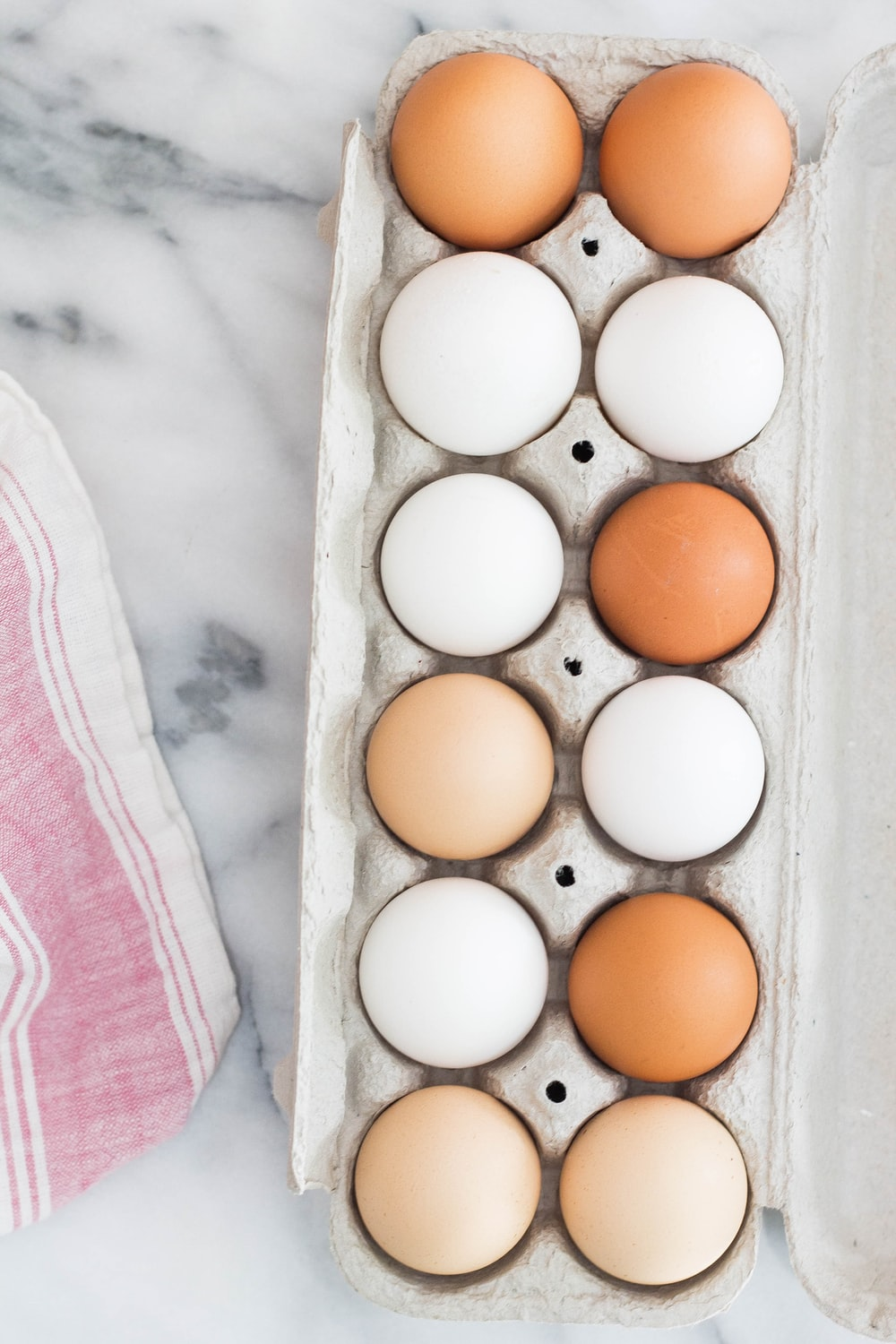 white and brown eggs in tray