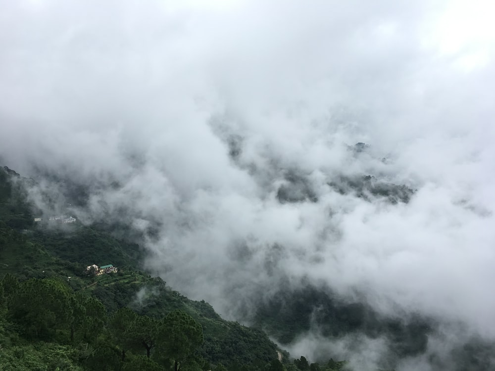 white clouds over a mountain