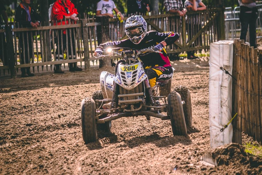 person riding ATV on mud road