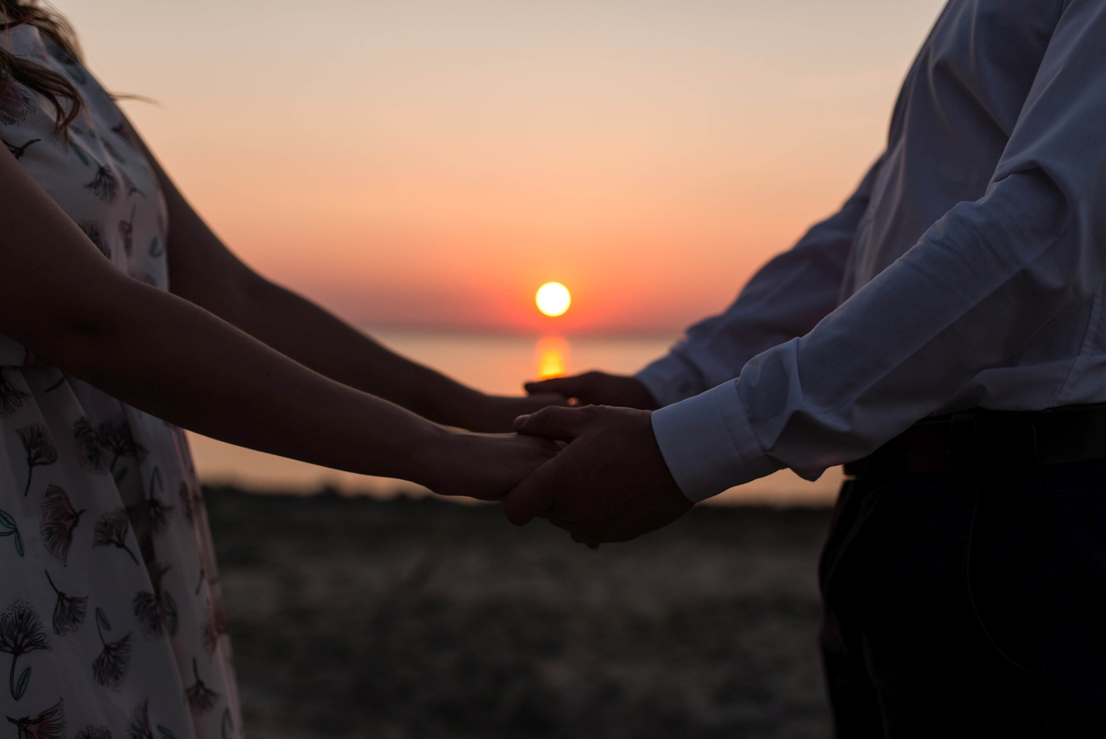 man and woman holding each others' hands