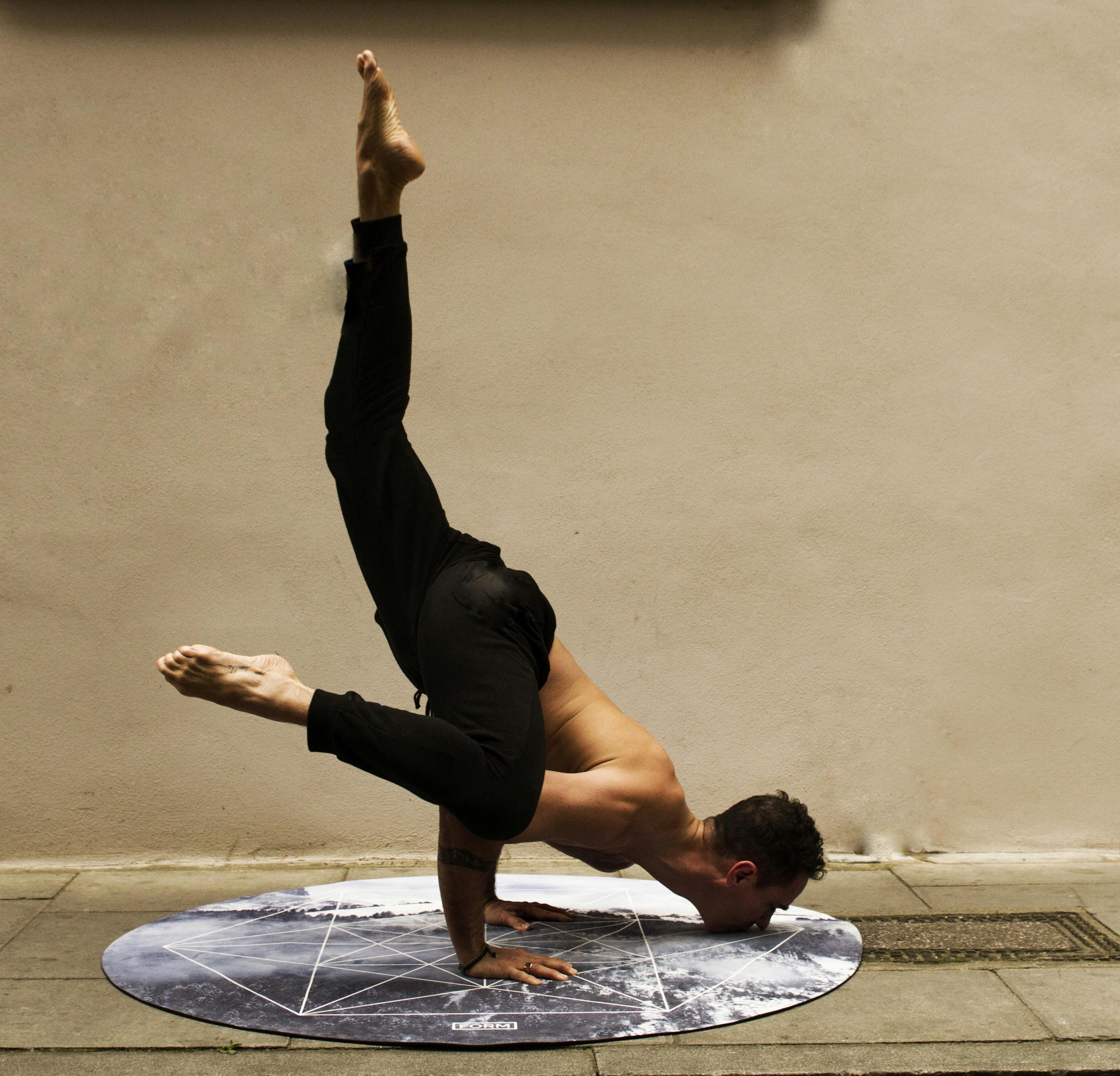 man doing stunt near brown wall