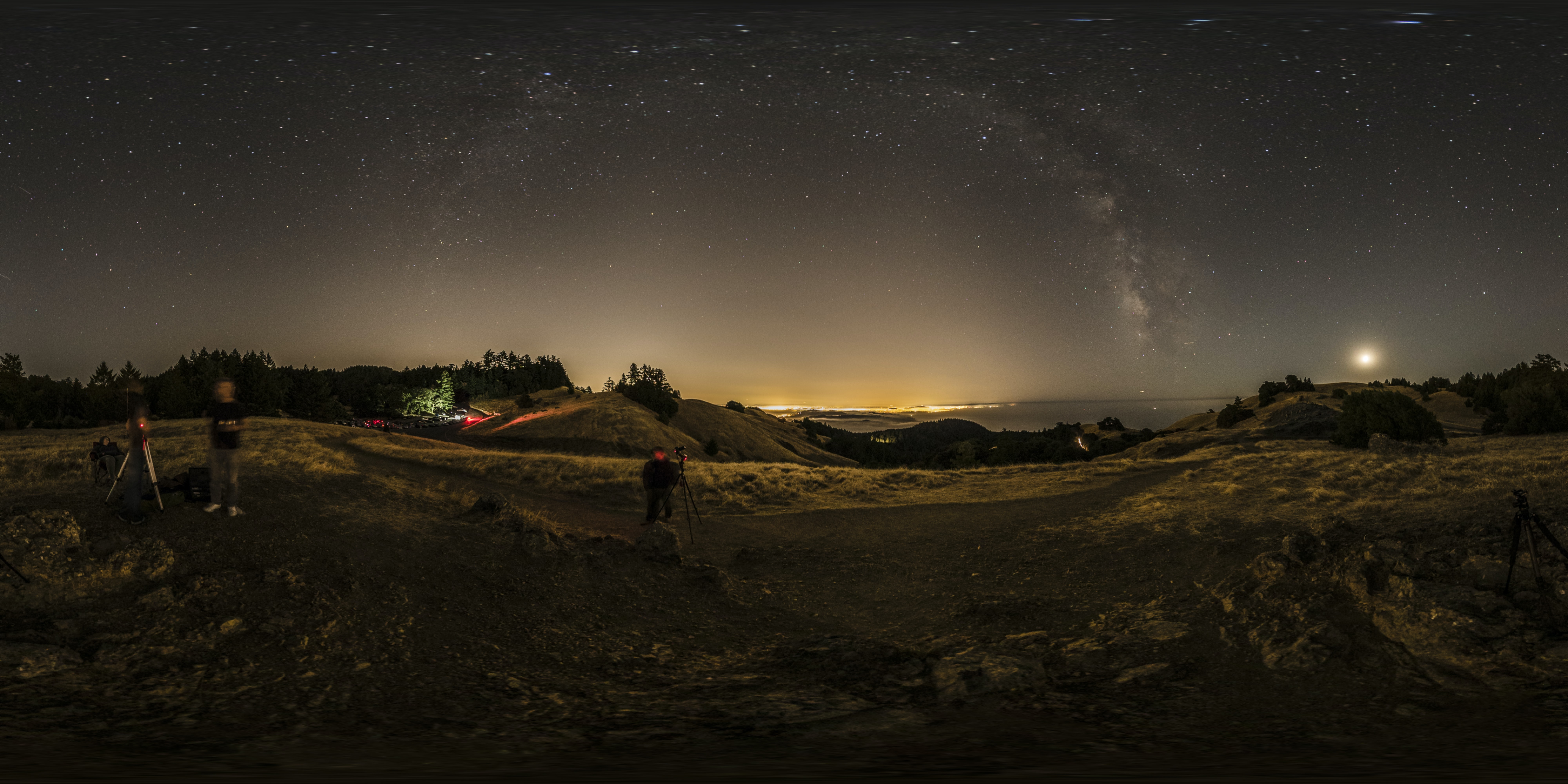 landscape photography of people camping on open area under gray sky at night time