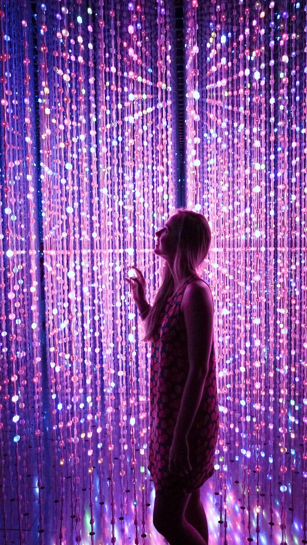 woman standing sting lights