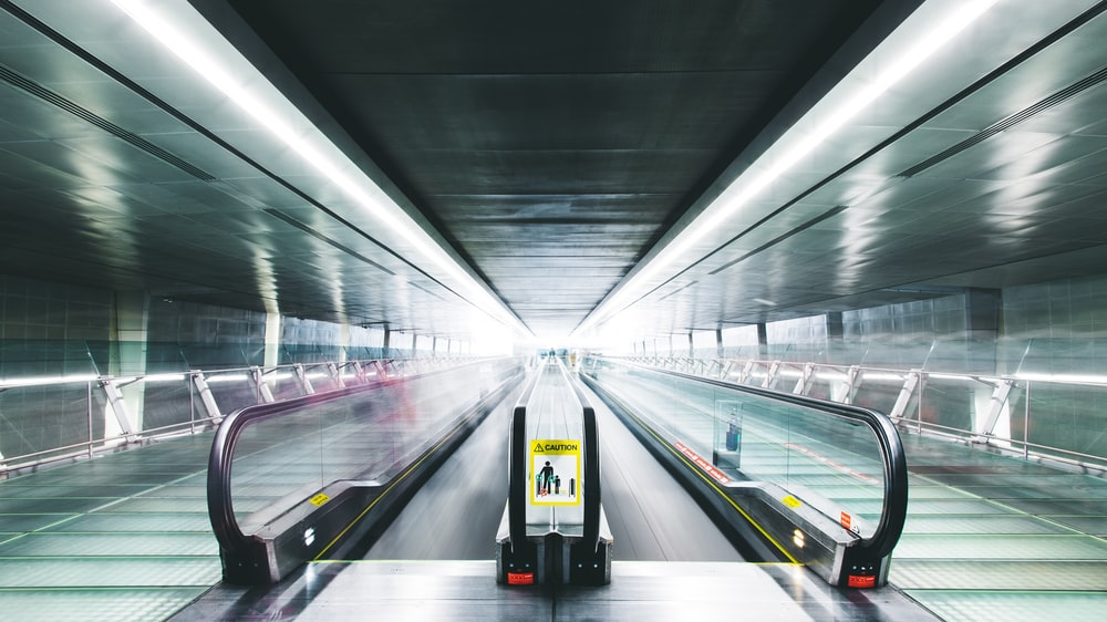 time lapse photography of black and gray escalator