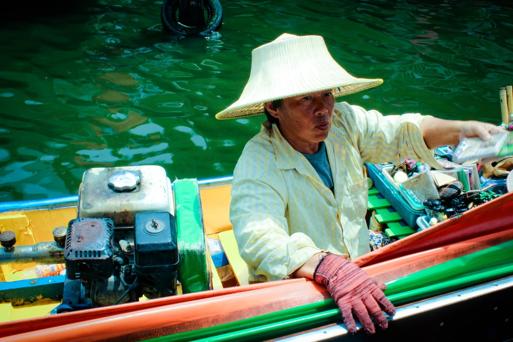 man ride on boat on body of water