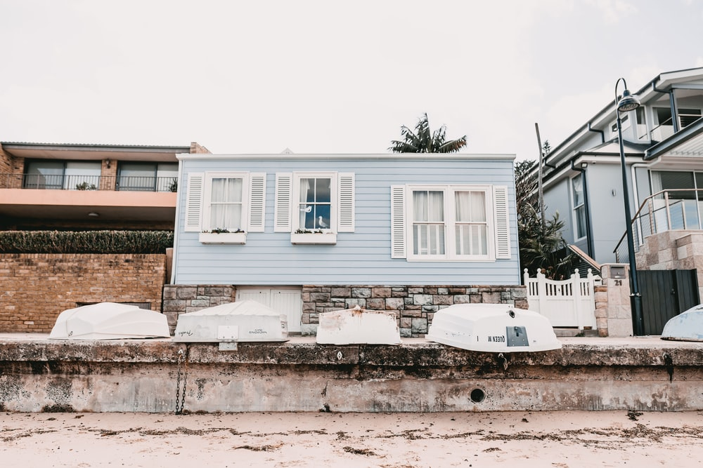photography of blue concrete house